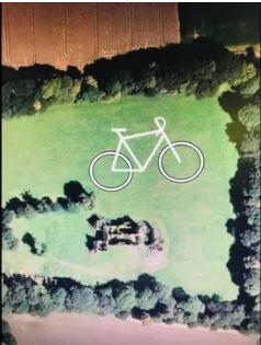 Vélo dessiné dans la prairie du château de Coëtcandec